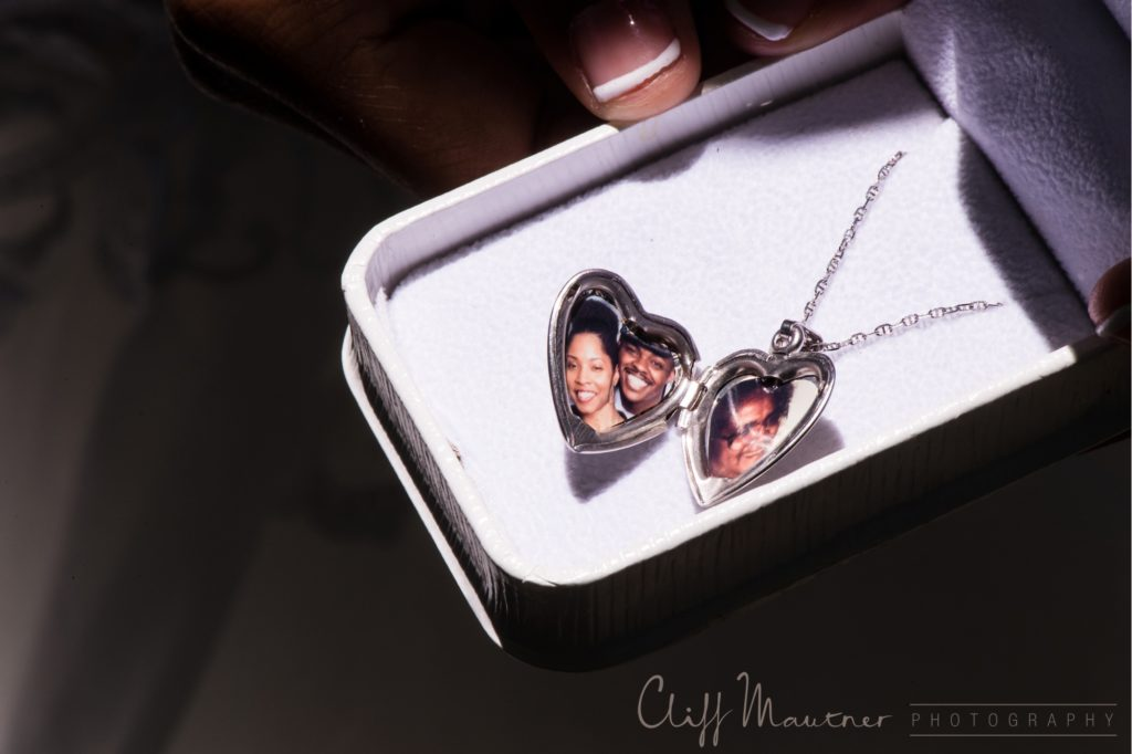 A heart shaped locket of the couple and beloved family member.