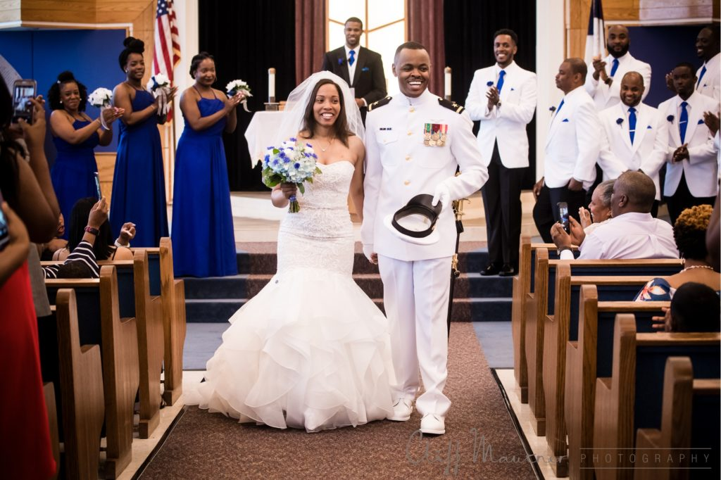 All smiles as the bride and groom walk down the aisle as officially husband and wife.