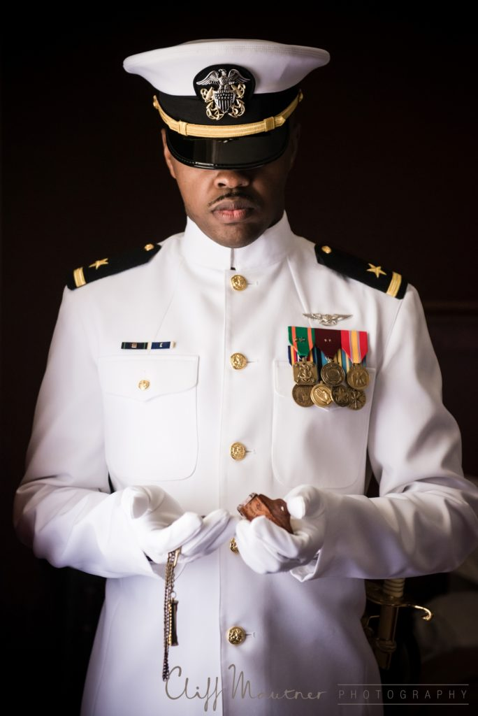 The groom dressed in his Naval officer uniform on his wedding day before the ceremony.